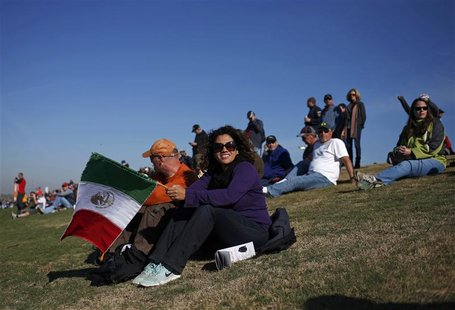 Fans of Sauber Formula One driver Sergio Perez of Mexico watch the third practice session of the U.S. F1 Grand Prix at the Circuit of the Am