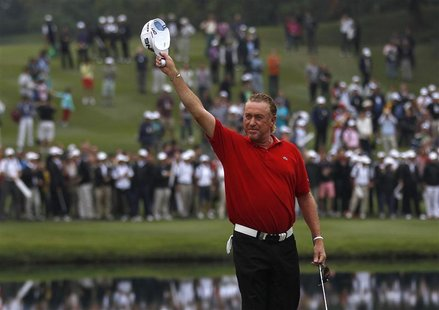 Miguel Angel Jimenez from Spain celebrates after winning the Hong Kong Open golf tournament November 18, 2012. REUTERS/Tyrone Siu