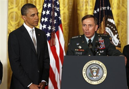 U.S. Army Gen. David Petraeus talks next to U.S. President Barack Obama at an event in the East Room of the White House in this April 28, 20