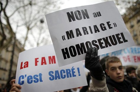 Opponents of same-sex marriage demonstrate against the government's draft law to legalise marriage and adoption for same-sex couples in Pari