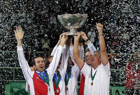 Czech Republic's team celebrates with the Davis Cup trophy after they defeated Spain in the final match in Prague November 18, 2012. REUTERS