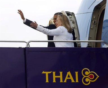 U.S. President Barack Obama and Secretary of State Hillary Clinton wave from the steps of Air Force One in Bangkok November 19, 2012. Poised