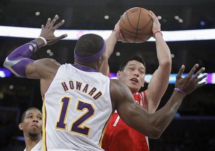 Houston Rockets point guard Jeremy Lin goes to the basket against Los Angeles Lakers center Dwight Howard (12) during their NBA basketball g