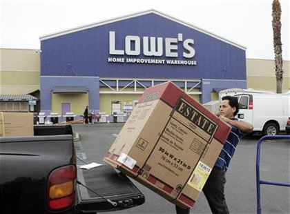 A contractor loads a bathroom vanity cabinet onto his truck after purchasing it at a Lowe's store in Burbank, California August 17, 2009. RE