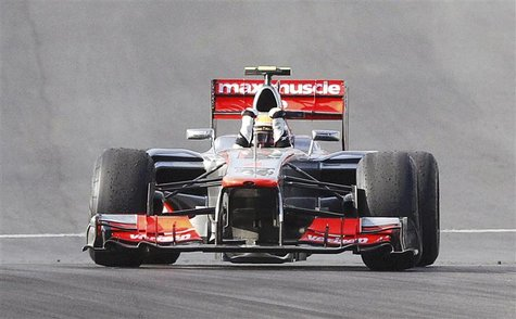 McLaren Formula One driver Lewis Hamilton of Britain celebrates after crossing the finish line to win the U.S. F1 Grand Prix at the Circuit