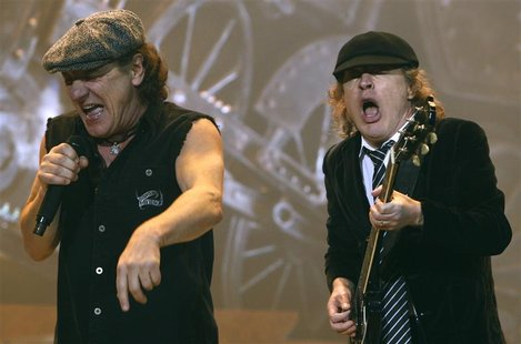 AC/DC lead vocalist Brian Johnson (L) and Angus Young performs at the O2 Millennium Dome stadium in London April 14, 2009. REUTERS/Luke MacG