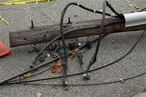 A fallen electric post belonging to the PSEG company is seen on a street in Union City, New Jersey, is this file photo taken November 2, 201