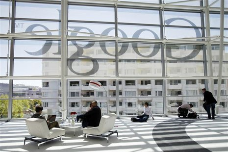 Attendees sits in front of a Google logo during Google I/O Conference at Moscone Center in San Francisco, California June 28, 2012. REUTERS/