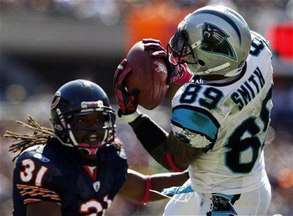 Carolina Panthers' wide receiver Steve Smith (R) catches a pass against Chicago Bears' free safety Brandon Meriweather during the first quar