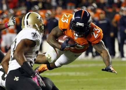 Denver Broncos running back Willis McGahee (23) flies to the 1-yard-line past New Orleans Saints cornerback Jabari Greer (L) in the first qu