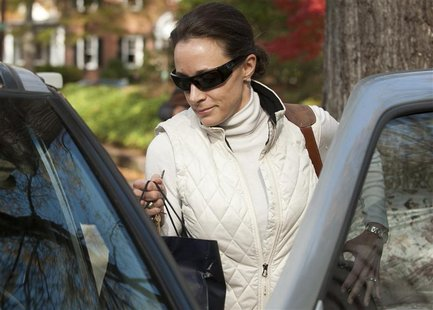 Paula Broadwell, the woman whose affair with CIA director David Petraeus led to his resignation, leaves her home in Charlotte, North Carolin
