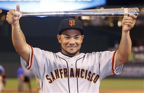 National League All-Star Melky Cabrera of the San Francisco Giants holds the MVP trophy after the National defeated the American League in M