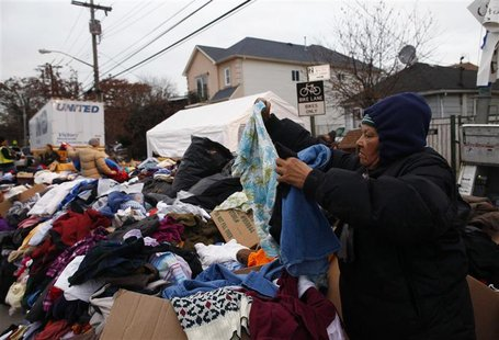 A woman searches through clothing donated to Hurricane Sandy victims in the Staten Island borough of New York November 19, 2012. REUTERS/Eri