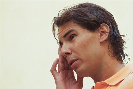 Spain's Rafael Nadal gestures between television interviews, during which he detailed reasons for pulling out of the U.S. Open, in Palma de