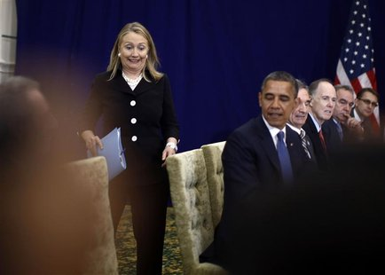 U.S. Secretary of State Hillary Clinton reacts as she arrives last for a meeting between President Barack Obama and Japan's Prime Minister Y