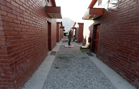A French soldier walks between buildings at the empty forward base before a handover ceremony between the French army and the ANA (Afghan Na