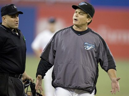 Toronto Blue Jays manager John Gibbons (R) stands on the field during their MLB baseball game against the New York Yankees in Toronto May 31