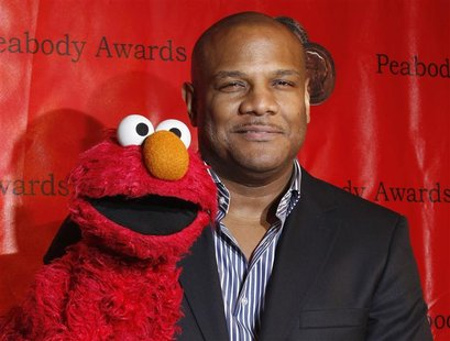 Voice actor Kevin Clash arrives with the puppet Elmo for the 2010 Peabody Award ceremony at the Waldorf Astoria in New York in this May 17,