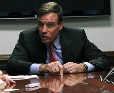 "U.S. Senator Mark Warner, who's expected to play a role in negotiations to avoid the ""fiscal cliff,"" speaks during an interview with Reuters"