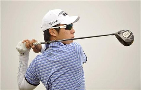 Choi Jin-ho of South Korea watches his shot during the third round of the Volvo China Open at Binhai Lake Golf Club in Tianjin municipality,
