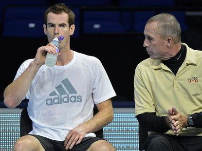 Andy Murray of Britain (L) speaks with his coach Ivan Lendl during a practice session ahead of the ATP tennis finals at the O2 Arena in Lond