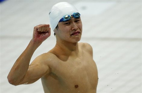China's Sun Yang reacts after winning the gold in the men's 1500m freestyle final with a world record during the London 2012 Olympic Games a