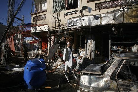 A man stands at the site of a bomb attack in Quetta November 21, 2012. REUTERS/Naseer Ahmed