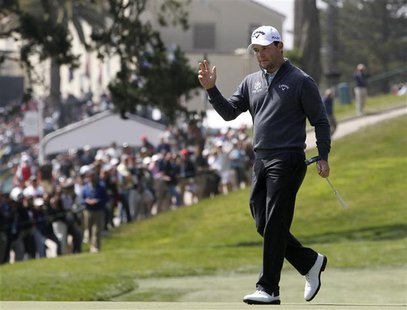 South Africa's Branden Grace reacts after his birdie on the third green during the first round for the 2012 U.S. Open golf championship on t