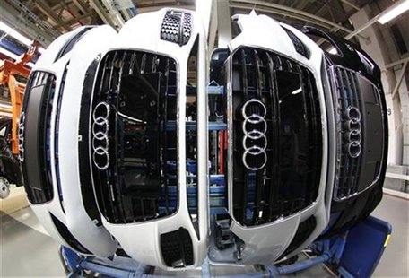 Audi A4 front parts with emblems are pictured at the production line of the German car manufacturer's plant in the Bavarian city of Ingolsta
