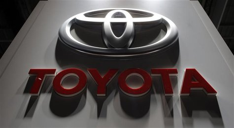 A logo is seen on the Toyota booth on media day at the Paris Mondial de l'Automobile, in this file picture taken September 27, 2012. REUTERS