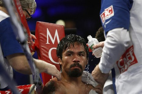 WBO welterweight champion Manny Pacquiao of the Philippines is treated in his corner between rounds during his title fight against Timothy B