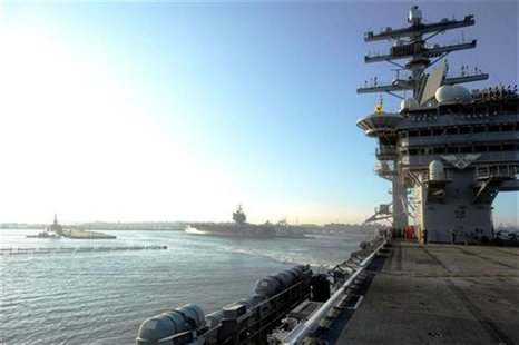 The aircraft carrier USS Dwight D. Eisenhower departs Naval Station Norfolk in this file photo taken August 25, 2011. REUTERS/Mass Communica