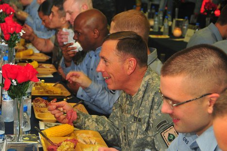 GULF OF OMAN (Nov. 26, 2009) Gen. David H. Petraeus, commander, U.S. Central Command, eats Thanksgiving dinner with a group of Sailors aboard the aircraft carrier USS Nimitz (CVN 68) By U.S. Navy photo by Mass Communication Specialist 3rd Class Matthew Patton [Public domain], via Wikimedia Commons