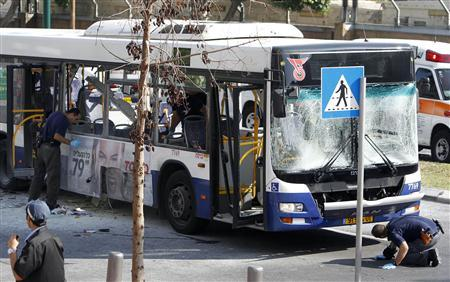 Israeli police survey the scene after an explosion on a bus in Tel Aviv November 21, 2012.  Credit: REUTERS/Nir Elias
