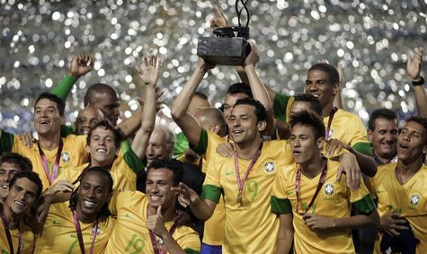 Brazil's soccer players celebrate with the trophy after winning the Clasico de Las Americas international friendly match against Argentina i