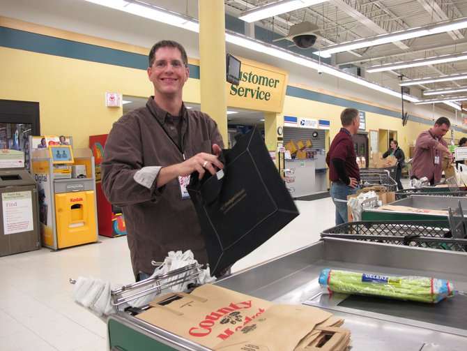 Joel..one of our big time marketing reps baggin' groceries..Go Joel!