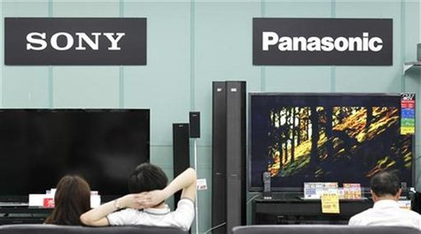 Sony and Panasonic TV sets are displayed at an electronic shop in Tokyo June 22, 2012. REUTERS/Kim Kyung-Hoon