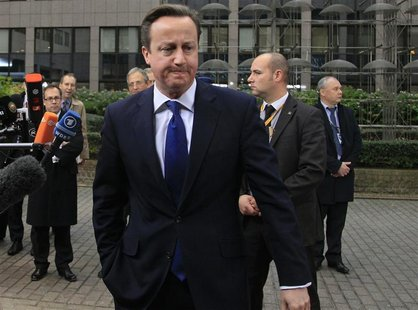 Britain's Prime Minister David Cameron arrives at the European Union (EU) council headquarters for an EU leaders summit discussing the EU's