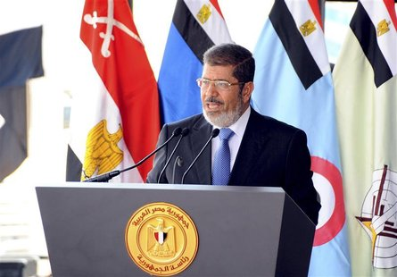 Egypt's President Mohamed Mursi speaks during his visit to the 6th armored division of the second army, in Ismailia October 10, 2012. REUTER