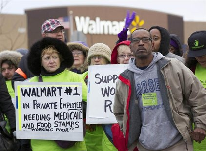 Protesters demonstrate outside a Walmart store in Chicago November 23, 2012. Black Friday, the day following the Thanksgiving Day holiday, h