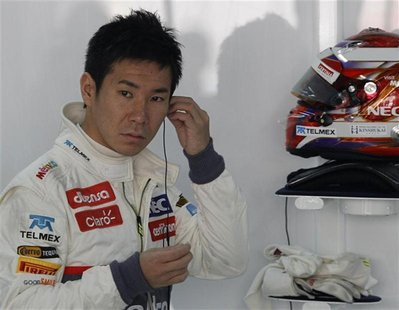Sauber Formula One driver Kamui Kobayashi of Japan gets ready for the first practice session of the Indian F1 Grand Prix at the Buddh Intern
