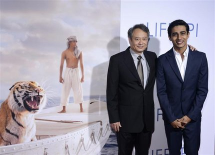 "Director Ang Lee (L) and actor Suraj Sharma (R) attend a special screening of the film ""The Life of Pi"" in Los Angeles November 16, 2012. RE"