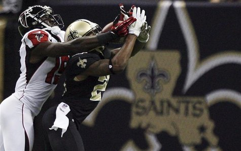 New Orleans Saints cornerback Corey White (24) intercepts a pass away from Atlanta Falcons wide receiver Drew Davis (19) during the second h