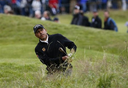 Jeev Milkha Singh watches his shot from the rough on the 15th hole during the second round of the British Open golf championship at Royal Ly