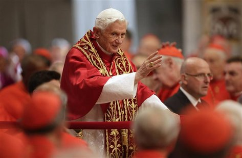 Pope Benedict XVI waves as he arrives to attend a consistory mass in St Peter's Basilica at the Vatican November 24, 2012. REUTERS/Tony Gent