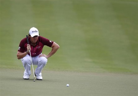 Rory McIlroy of Northern Ireland lines up his shot on the third green during the third round of the DP World Championship at Jumeirah Golf E