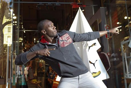 Jamaica's double Olympic champion sprinter Usain Bolt stikes a pose while inaugurating a Puma store in Barcelona November 23, 2012. REUTERS/