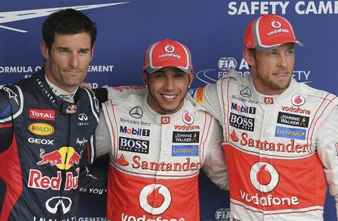 (L to R) Red Bull Formula One driver Mark Webber of Australia, McLaren drivers Lewis Hamilton and Jenson Button of Britain pose for photos a