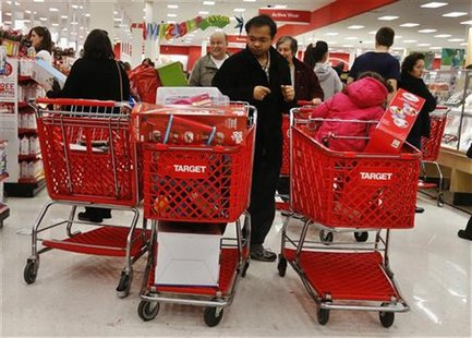 People shop at a Target store in Westbury, New York November 23, 2012. Black Friday, the day following the Thanksgiving Day holiday, has tra