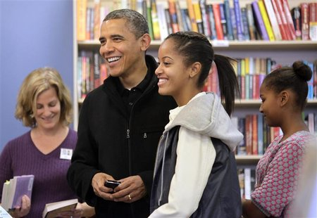 U.S. President Barack Obama and his daughters Malia and Sasha (R) visit One More Page bookstore in Arlington, Virginia, November 24, 2012. R